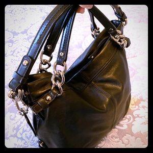 Coach timeless black leather satchel handbag.